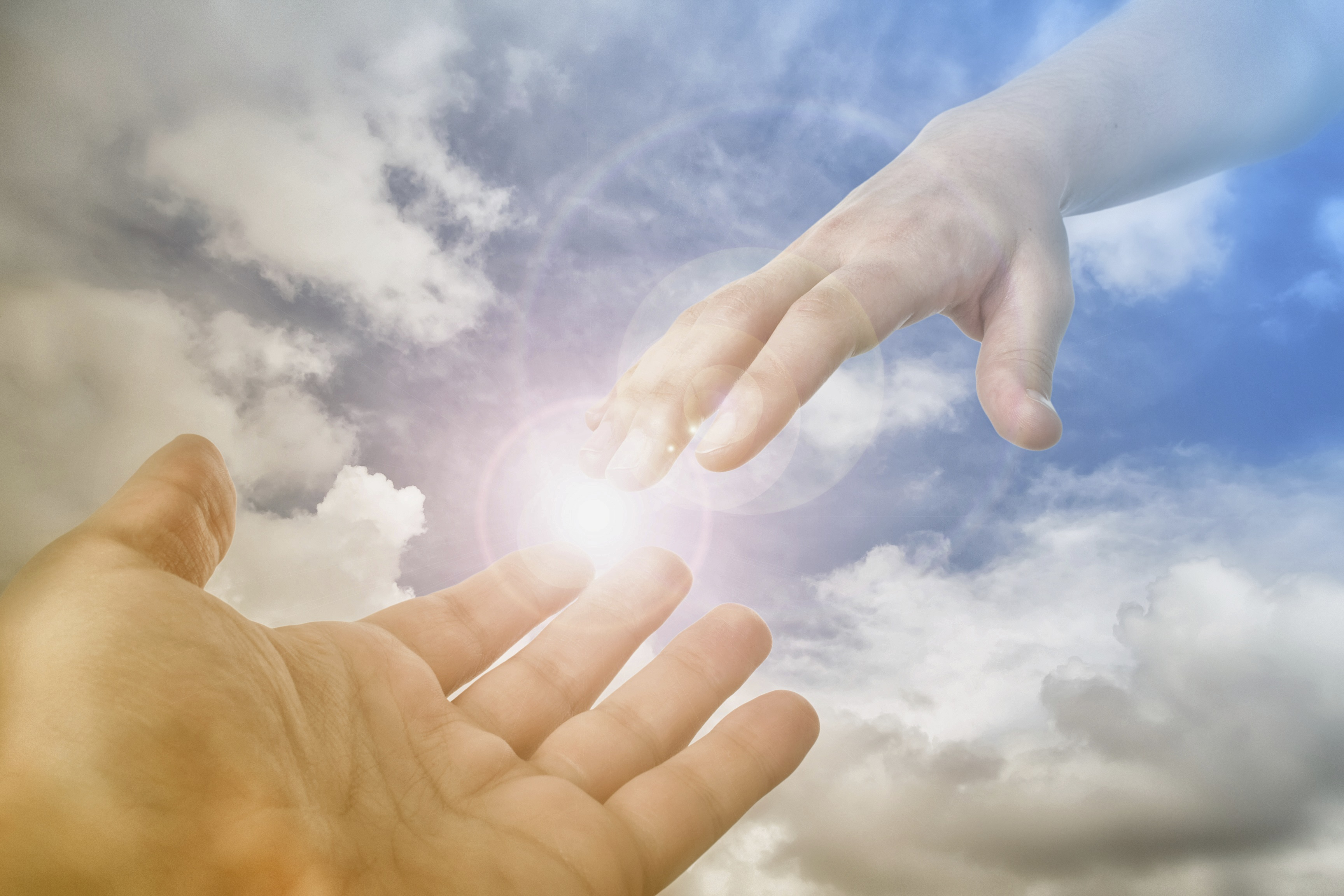 gods-hand-reaching-out-to-man
